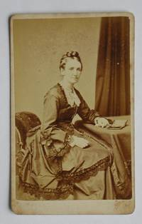 Carte De Visite Photograph: A Studio Portrait of a Finely Dressed Lady.