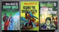 image of THE NI'LACH SERIES VOLUMES 2, 3 & 4.  2. SHADOW SINGER.  3. BEYOND THE DRAAK'S TEETH.  3. SEEKING THE DREAM BROTHER.  3 BOOKS IN TOTAL.