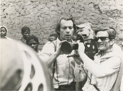 N.p.: N.p., 1971. Vintage borderless reference photograph of director Pier Paolo Pasolini and uniden...