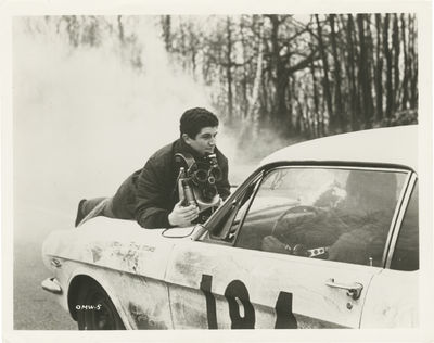 N.p.: N.p., 1966. Vintage reference photograph of director Claude Lelouch (who was also the cinemato...