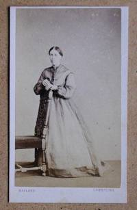 Carte De Visite Photograph: Portrait of a Woman Wearing a Long Gown.