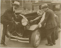 image of Archive of twelve original photographs of remote controlled automobiles, circa 1920s