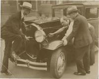 Archive of twelve original photographs of remote controlled automobiles, circa 1920s