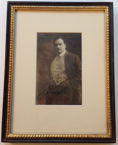 London, 1911. unbound. 1 page on a sepia-tone postcard featuring Caruso in suit and tie measuring 5 ...