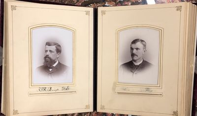 Very Good. Collection of 28 cabinet card portraits dating to the 1880s-90s, housed in an ornate velv...