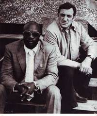 Publicity still of Issac Hayes and Lino Ventura in Tough Guys (1974) by Columbia Films S.A - from Alan Wofsy Fine Arts (SKU: 08-0036)