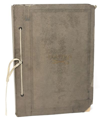 np, nd. Paperback. Very Good. Ribbon-bound scrapbook with dull gilt �Clippings� and scissors image o...