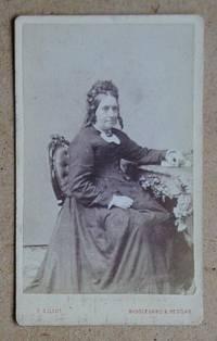 Carte De Visite Photograph: Portrait of a Woman Seated at a Desk.