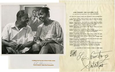N.p.: N.p., 1960. Photograph of Louis Armstrong at home, holding his trumpet, with his wife Louise. ...