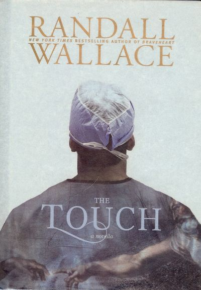 2011. WALLACE, Randall. THE TOUCH. Carol Stream, Illinois: Tyndale House Publishers, Inc., . 8vo., b...