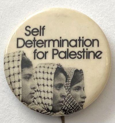 n.p.: n.pub, . 1.5 inch pin with photo of three women wearing keffiyeh.
