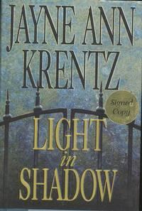 Light in Shadow : A Whispering Springs Novel.