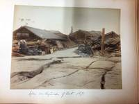 MEIJI PERIOD PHOTO ALBUM with 50 Hand-Colored Albumen Photographs Including the Aftermath of the Great Earthquake of 1891
