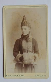 Carte De Visite Photograph: A Portrait of a Finely Dressed Young Lady with a Fur Muff.