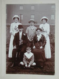 A Charming Outside Group Portrait of a Family Dressed in Their Best.