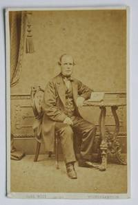 Carte De Visite Photograph. A Studio Portrait of a Gentleman Seated at a Table with Books.