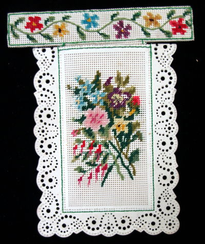 Measures 5� x 3 ½� with needlepoint strip across that top that has a handmade patch or court plaste...
