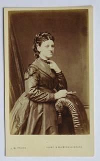 Carte De Visite Photograph. Studio Portrait of a Finely Dressed Young Woman.
