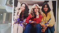 SIGNED Color Oblong Photograph of All 3 Original Charlies Angels Seated Smiling Wearing Beige, Red & Yellow Tops Farrah Fawcett, Kate Jackson, Jacqueline Smith TV Series