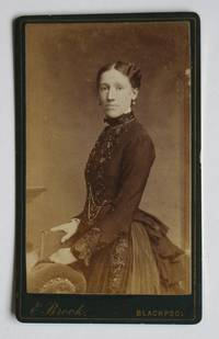 Carte De Visite Photograph. Portrait of a Young Lady Holding a Book. by E. Brook - from N. G. Lawrie Books. (SKU: 47907)