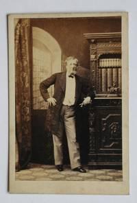 image of Carte De Visite Photograph. A Studio Portrait of an Unknown Gentleman Beside a Bookcase Cabinet.