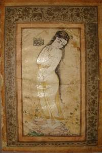 Portrait of a standing yong female with long hair holding a clip, signed: Raqm i kamineh (R)