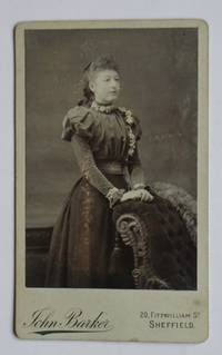 Carte De Visite Photograph: Portrait of a Finely Dressed Young Woman. by John Barker - from N. G. Lawrie Books. (SKU: 47915)