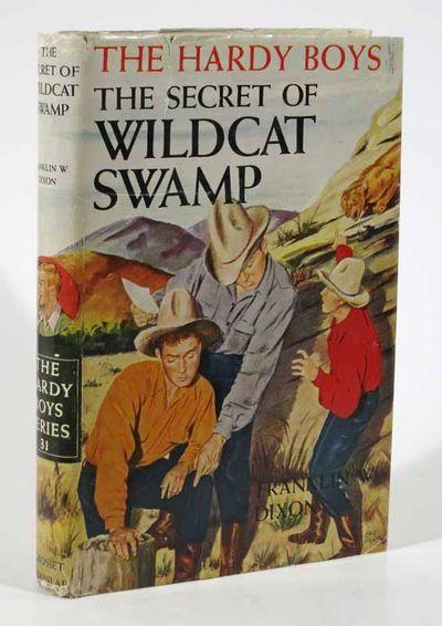 New York: Grosset & Dunlap, 1952. Later printing, ca 1955. Beige tweed cloth binding with dark brown...