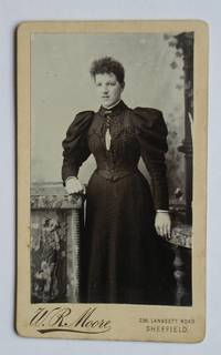 image of Carte De Visite Photograph: Portrait of a Finely Dressed Young Woman.