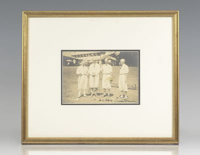 Photograph of baseball legend Ty Cobb posing on a golf course with three other golfers, signed by Ty...