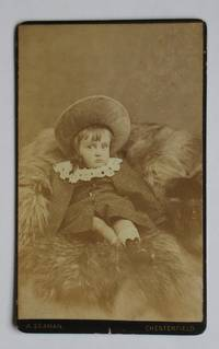 Carte De Visite Photograph: Studio Portrait of a Young Child with a Bonnet on a Fur Rug. by A. Seaman - from N. G. Lawrie Books. (SKU: 47913)