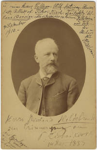 "Original bust-length cabinet card portrait photograph of the composer by Konstantine Šapiro of St. Petersburg. With an autograph inscription signed by Tchaikovsky: ""Herrn Richard Hildebrand zur Erinnerung an P. Tschaikovsky 14 Dec. 1887. Aus Kopenhagen werde[...] 25 Januar schreiben."""